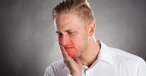 man in dental pain